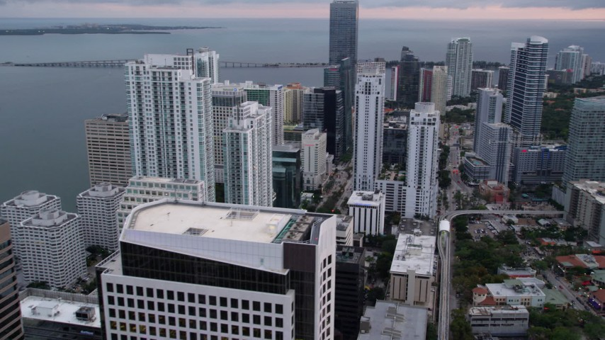5K stock footage aerial video of skyscrapers by the shore of the bay in Downtown Miami at sunset, Florida Aerial Stock Footage | AX0022_067