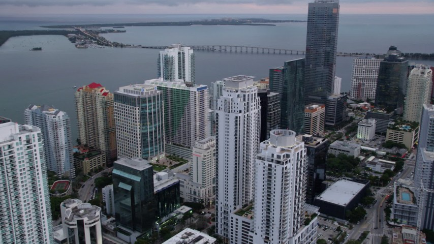 5K stock footage aerial video flyby waterfront high-rises in Downtown Miami at sunset, Florida Aerial Stock Footage | AX0022_068