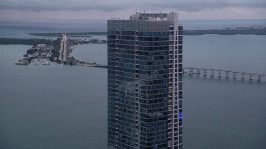 5K stock footage aerial video flyby the top of the Four Seasons Hotel tower at sunset in Downtown Miami, Florida Aerial Stock Footage | AX0022_069