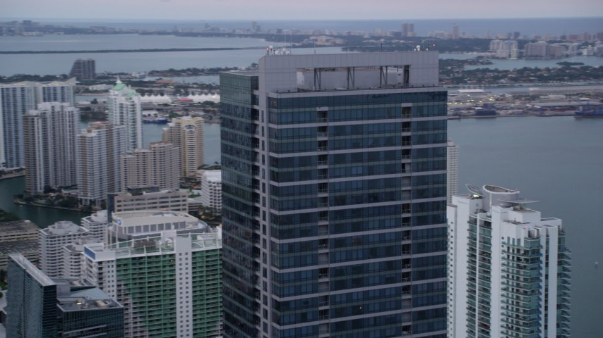 5K stock footage aerial video orbit the top of the Four Seasons Hotel at sunset in Downtown Miami, Florida Aerial Stock Footage | AX0022_070