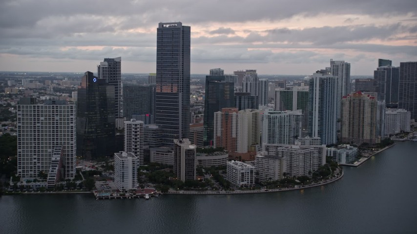 5K stock footage aerial video approach waterfront skyscrapers and high-rise hotel at sunset in Downtown Miami, Florida Aerial Stock Footage | AX0022_078