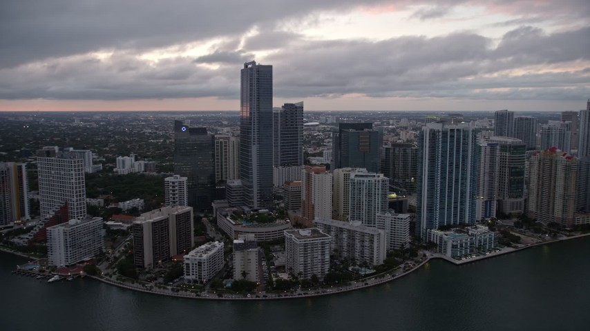 5K stock footage aerial video flyby high-rise hotel and waterfront skyscrapers at sunset in Downtown Miami, Florida Aerial Stock Footage | AX0022_079E