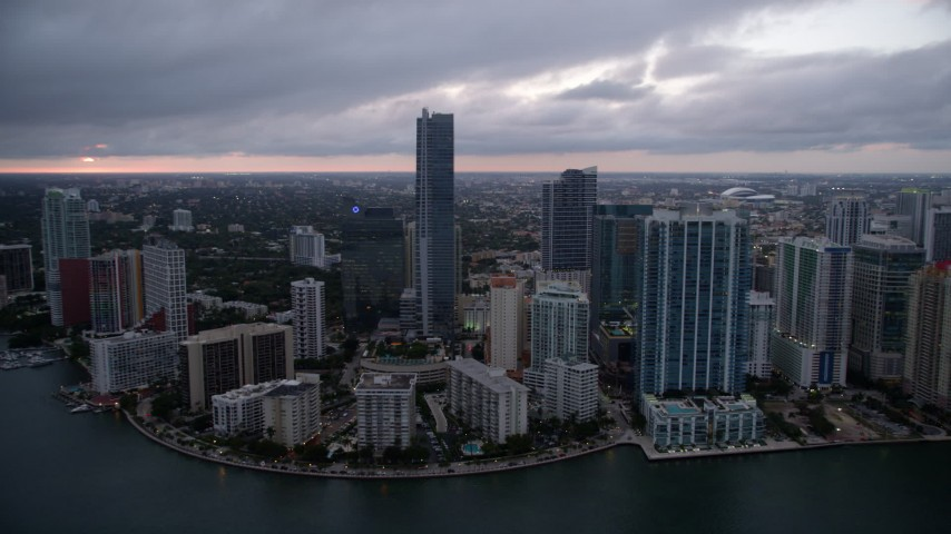 5K stock footage aerial video of hotel skyscrapers and waterfront high-rises at sunset in Downtown Miami, Florida Aerial Stock Footage | AX0022_080