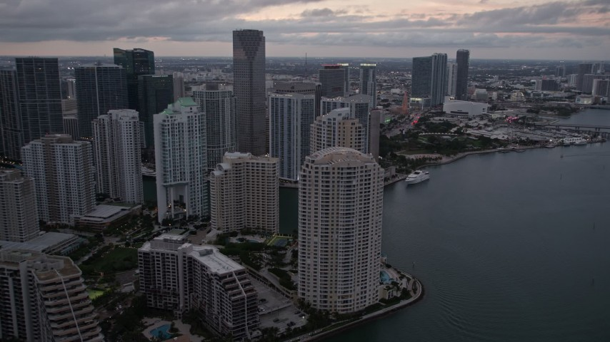 5K stock footage aerial video of Brickell Key skyscrapers at sunset, reveal the river in Downtown Miami, Florida Aerial Stock Footage | AX0022_081E