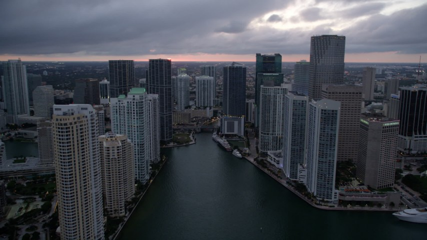 5K stock footage aerial video of Miami River and riverfront skyscrapers at sunset in Downtown Miami, Florida Aerial Stock Footage | AX0022_083