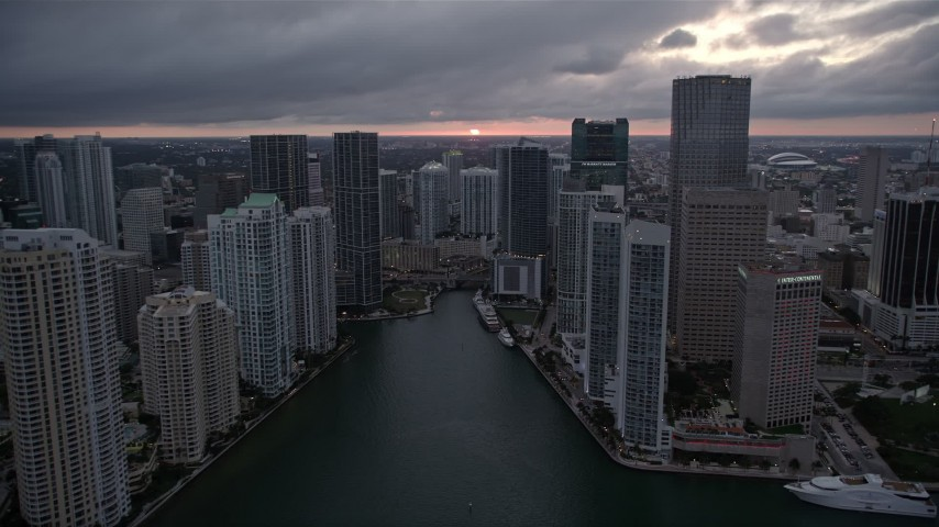 5K stock footage aerial video of Miami River and riverfront skyscrapers at sunset in Downtown Miami, Florida Aerial Stock Footage | AX0022_083E