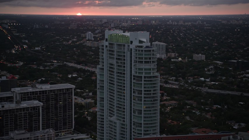 5K aerial video approach the Santa Maria condo high-rise at sunset in Downtown Miami, Florida Aerial Stock Footage | AX0022_092