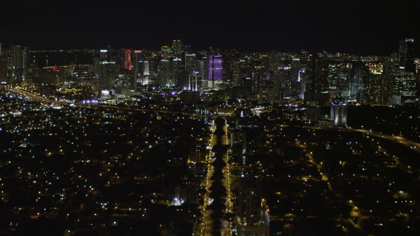 5K stock footage aerial video follow SW 3rd Avenue toward Downtown Miami skyline at night, Florida Aerial Stock Footage   AX0023_004