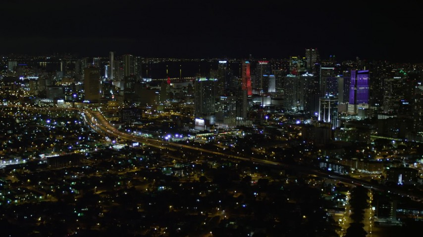 5K stock footage aerial video approach the Downtown Miami skyline at night, Florida Aerial Stock Footage   AX0023_006