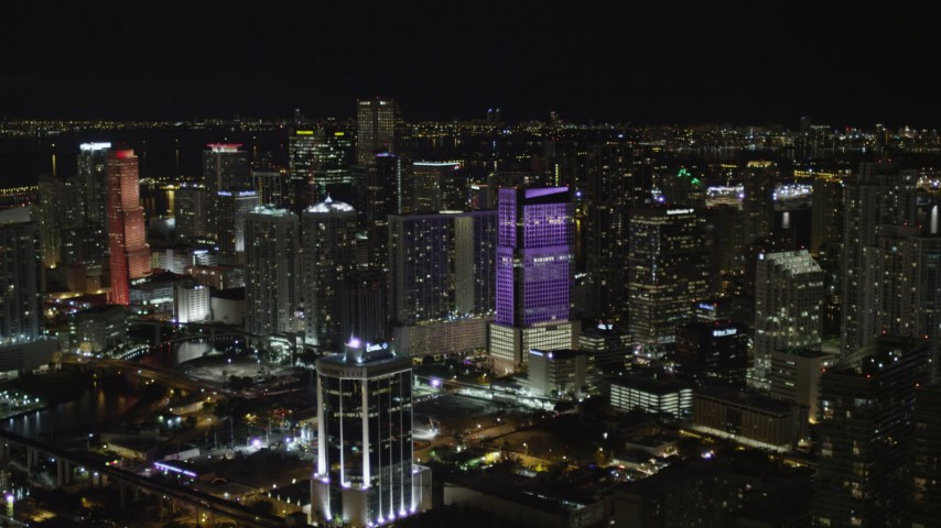 5K stock footage aerial video approach Brickell World Plaza at night in Downtown Miami, Florida Aerial Stock Footage | AX0023_008