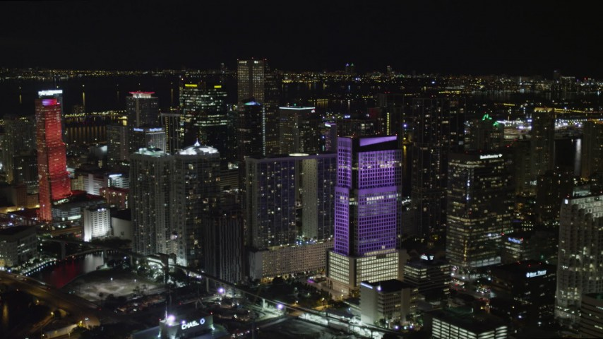5K stock footage aerial video of approaching Brickell World Plaza at night in Downtown Miami, Florida Aerial Stock Footage | AX0023_009