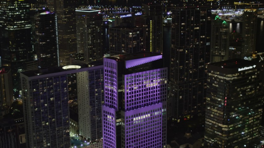 5K stock footage aerial video approach the roof of Brickell World Plaza in Downtown Miami at night, Florida Aerial Stock Footage | AX0023_010