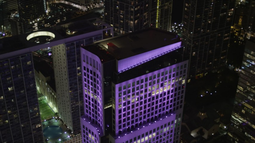 5K aerial video tilt to bird's eye view Brickell World Plaza at night in Downtown Miami, Florida Aerial Stock Footage | AX0023_011