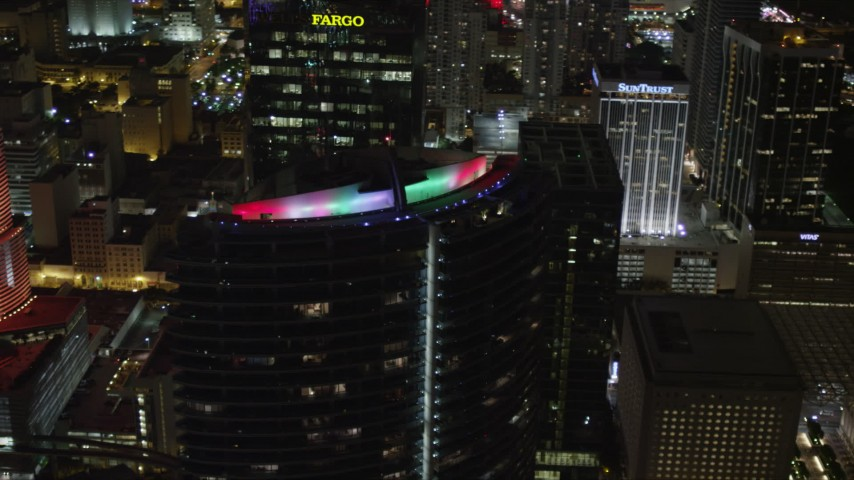 5K stock footage aerial video orbit colorful lights on the roof of Epic Hotel at night in Downtown Miami, Florida Aerial Stock Footage | AX0023_012