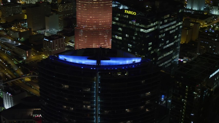 5K stock footage aerial video orbit colorful lights on the roof of Epic Hotel at night in Downtown Miami, Florida Aerial Stock Footage | AX0023_012E