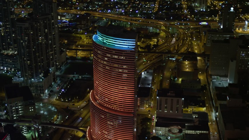 5K stock footage aerial video of Miami Tower with colorful lights at night in Downtown Miami, Florida Aerial Stock Footage | AX0023_014E