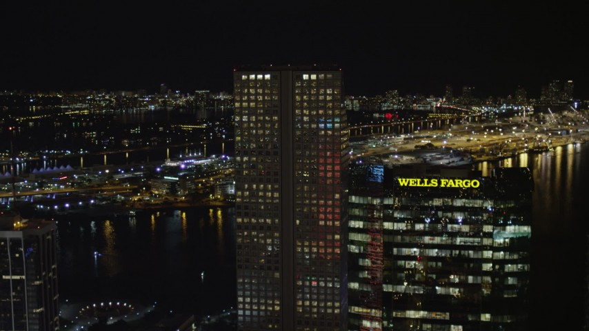 5K stock footage aerial video approach Southeast Financial Center in Downtown Miami at night, Florida Aerial Stock Footage | AX0023_018