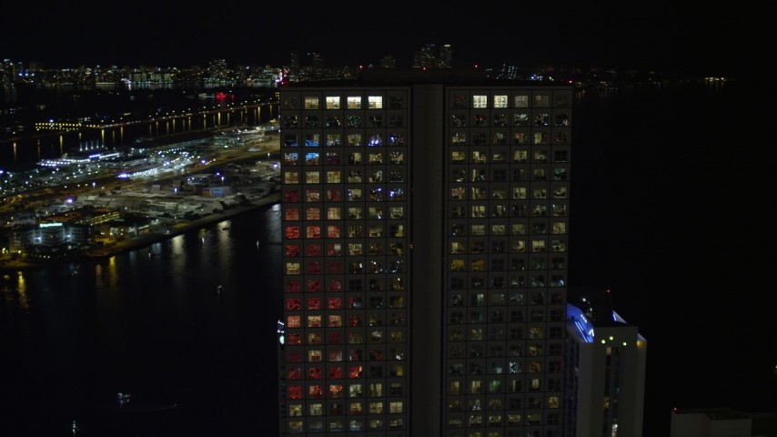 5K stock footage aerial video approach and orbit Southeast Financial Center in Downtown Miami at night, Florida Aerial Stock Footage | AX0023_018E