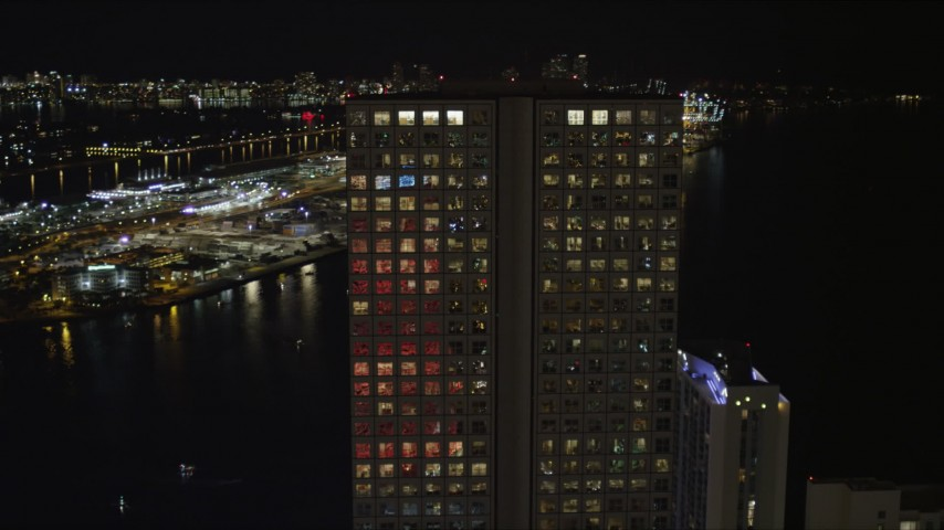 5K stock footage aerial video flyby top floors of Southeast Financial Center at night in Downtown Miami, Florida Aerial Stock Footage | AX0023_019