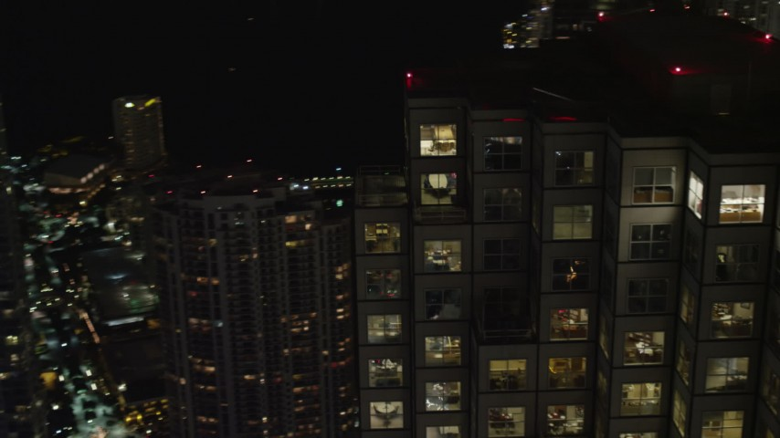 5K aerial video orbit the top floors of Southeast Financial Center at night in Downtown Miami, Florida Aerial Stock Footage | AX0023_020