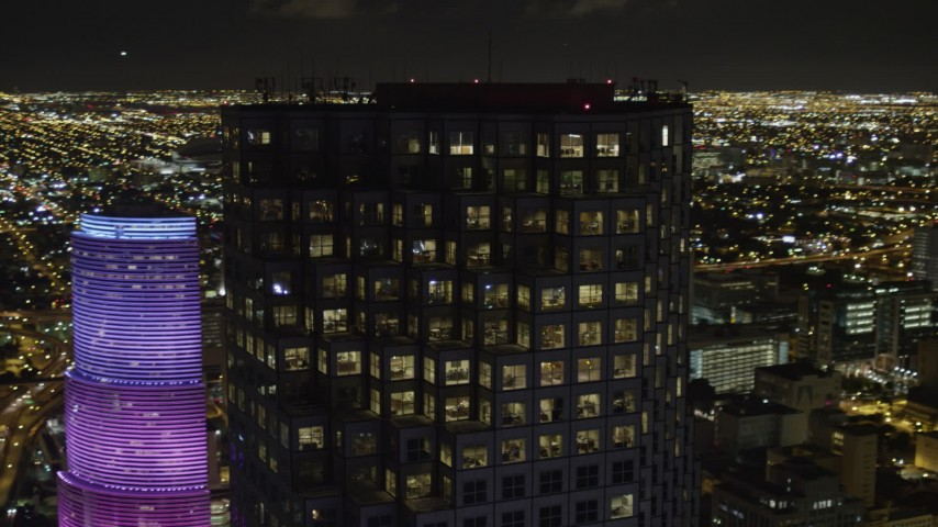 5K stock footage aerial video of the upper floors of Southeast Financial Center at night in Downtown Miami, Florida Aerial Stock Footage | AX0023_021