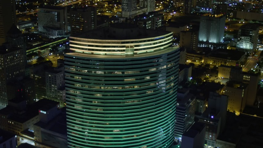 5K stock footage aerial video of Miami Tower in Downtown Miami at night, Florida Aerial Stock Footage | AX0023_022