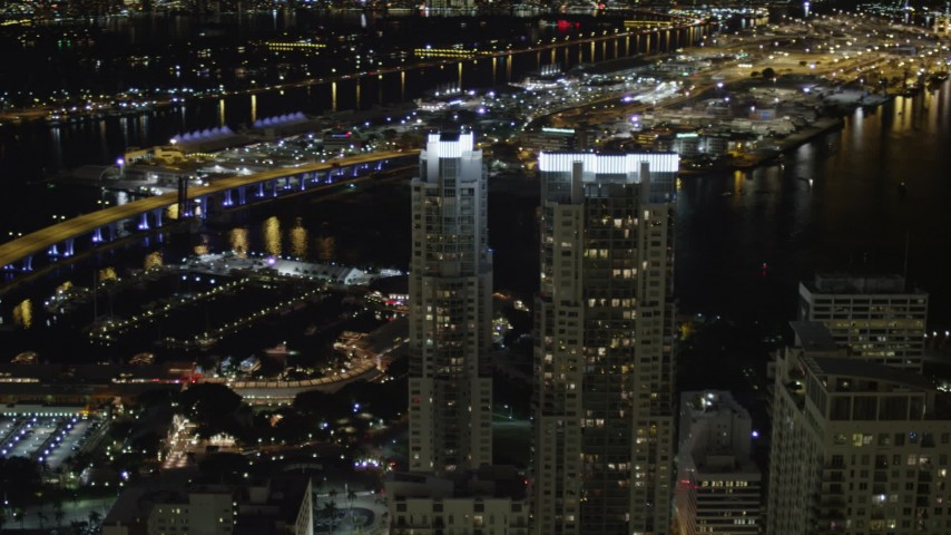 5K stock footage aerial video orbit Vizcayne Towers at night in Downtown Miami, Florida Aerial Stock Footage | AX0023_023