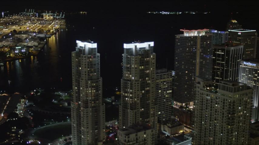 5K stock footage aerial video orbit twin towers of Vizcayne skyscrapers at night in Downtown Miami, Florida Aerial Stock Footage | AX0023_024