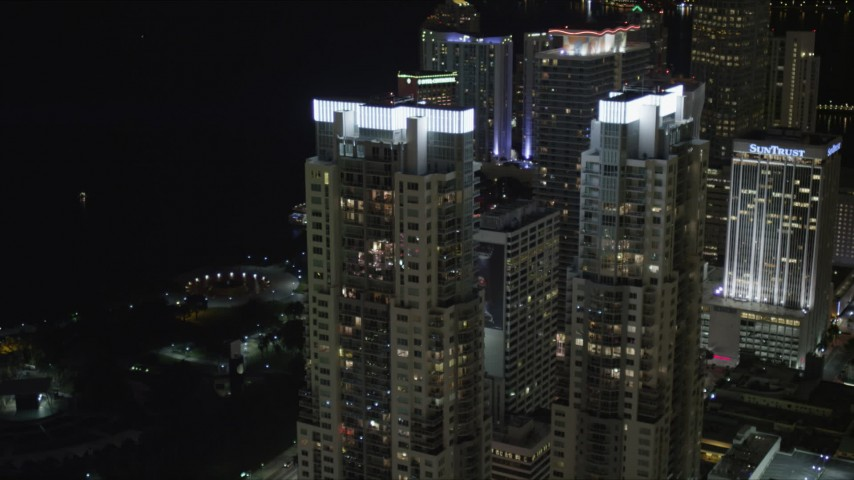 5K stock footage aerial video of illuminated rooftops of Vizcayne towers at Night in Downtown Miami, Florida Aerial Stock Footage | AX0023_025