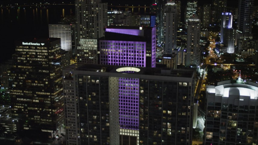 5K stock footage aerial video of approaching 500 Brickell at night in Downtown Miami, Florida Aerial Stock Footage | AX0023_028