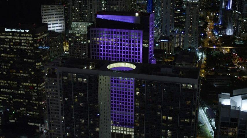 5K stock footage aerial video of approaching 500 Brickell and Brickell World Plaza at night in Downtown Miami, Florida Aerial Stock Footage | AX0023_028E