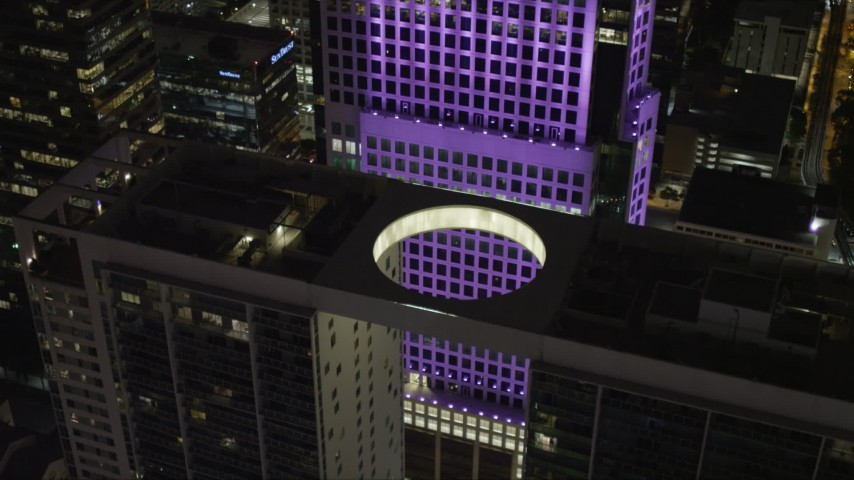 5K stock footage aerial video of a bird's eye view of the 500 Brickell Rooftop at night in Downtown Miami, Florida Aerial Stock Footage | AX0023_029