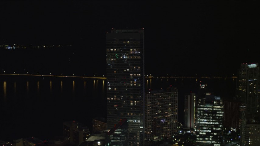 5K stock footage aerial video approach Four Season Hotel tower at night in Downtown Miami, Florida Aerial Stock Footage | AX0023_031