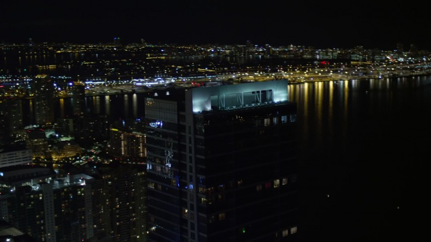 5K stock footage aerial video approach and orbit Four Season Hotel tower at night in Downtown Miami, Florida Aerial Stock Footage | AX0023_031E