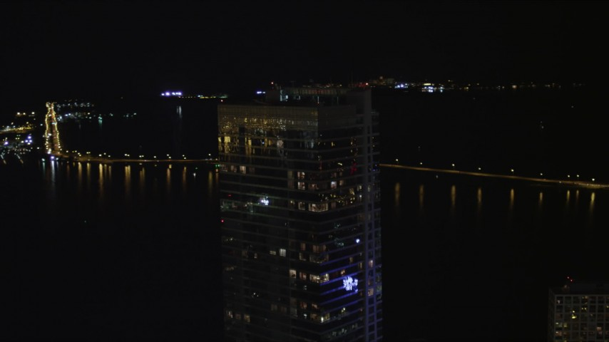 5K stock footage aerial video orbit top of Four Seasons Hotel in Downtown Miami at night, Florida Aerial Stock Footage   AX0023_032
