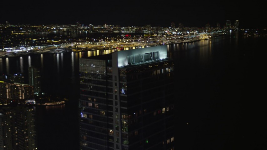 5K stock footage aerial video of rooftop of the Four Seasons Hotel in Downtown Miami at night, Florida Aerial Stock Footage | AX0023_033