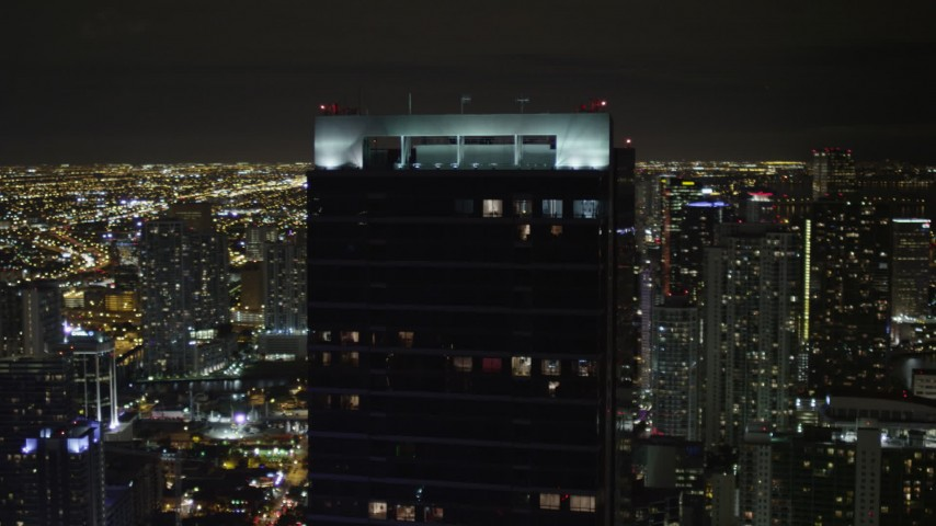 5K stock footage aerial video of the top of Four Seasons Hotel high-rise at night in Downtown Miami, Florida Aerial Stock Footage | AX0023_034