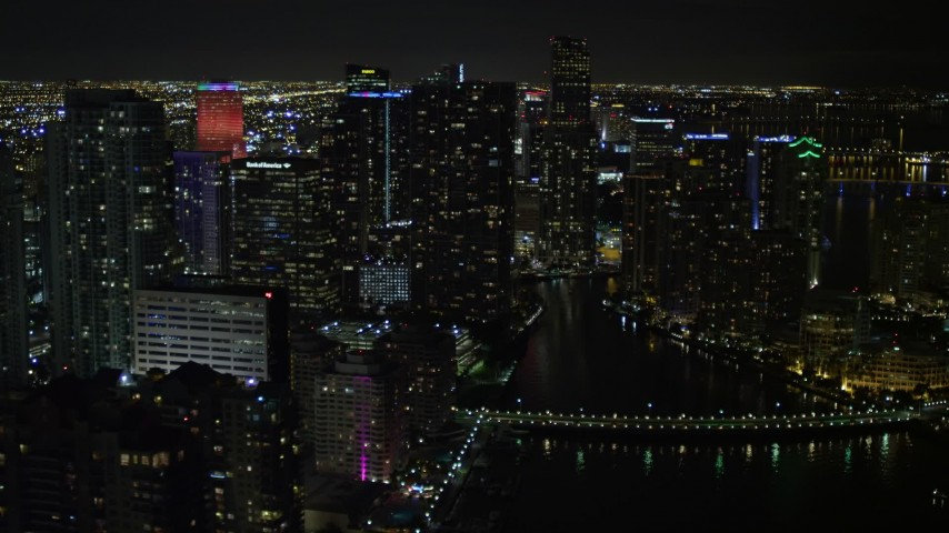 5K stock footage aerial video of Brickell Key and Downtown Miami skyscrapers at nighttime, Florida Aerial Stock Footage | AX0023_035