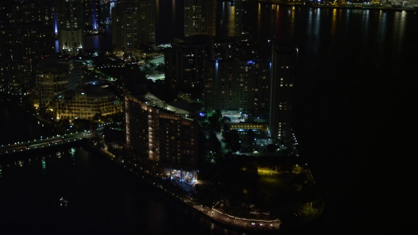 5K stock footage aerial video approach Mandarin Oriental Hotel on Brickell Key in Downtown Miami at night, Florida Aerial Stock Footage | AX0023_036