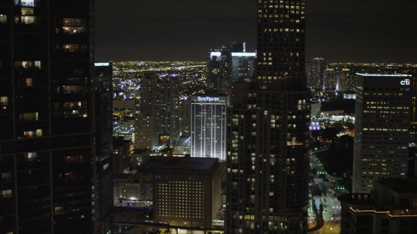 5K stock footage aerial video of approaching tall skyscrapers in Downtown Miami at night, Florida Aerial Stock Footage | AX0023_038