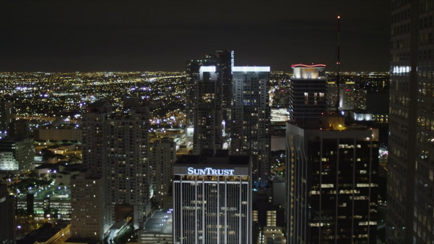 5K stock footage aerial video approach twin skyscrapers at night in Downtown Miami, Florida Aerial Stock Footage | AX0023_039