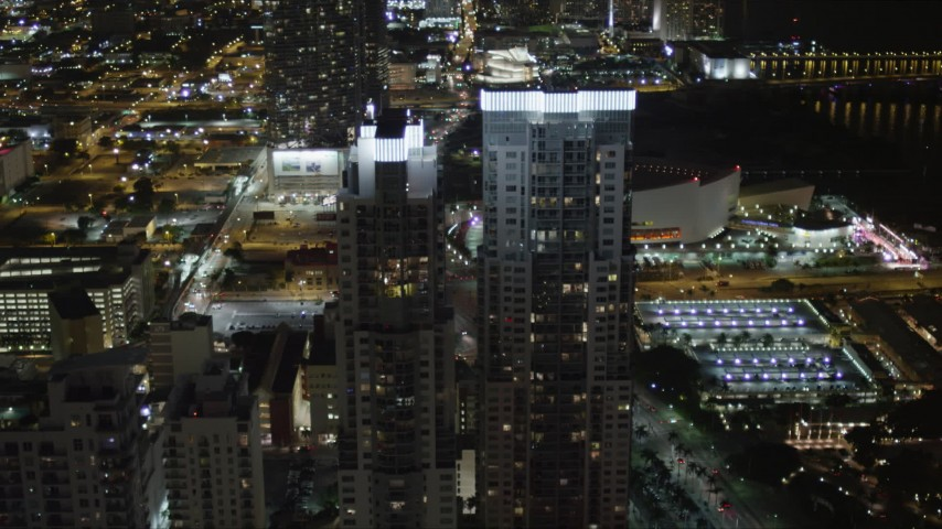 5K stock footage aerial video approach the towers of Vizcayne at night in Downtown Miami, Florida Aerial Stock Footage | AX0023_040