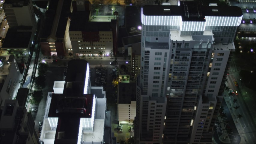 5K stock footage aerial video of tilt to bird's eye view of Vizcayne skyscrapers at night in Downtown Miami, Florida Aerial Stock Footage | AX0023_041