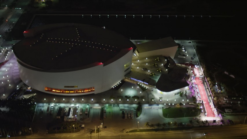 5K stock footage aerial video of American Airlines Arena at night in Downtown Miami, Florida Aerial Stock Footage | AX0023_042