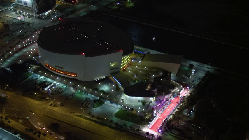 5K stock footage aerial video of American Airlines Arena at night in Downtown Miami, Florida Aerial Stock Footage | AX0023_042E