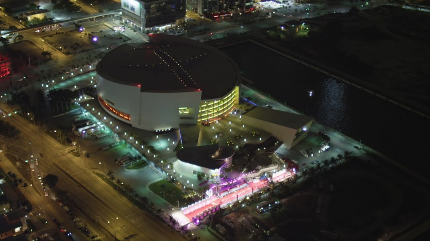5K stock footage aerial video orbit of American Airlines Arena in Downtown Miami, Florida at night Aerial Stock Footage | AX0023_043