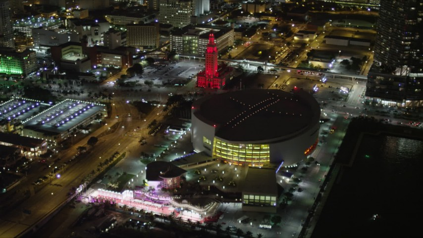 5K stock footage aerial video orbiting the American Airlines Arena in Downtown Miami at night, Florida Aerial Stock Footage | AX0023_044