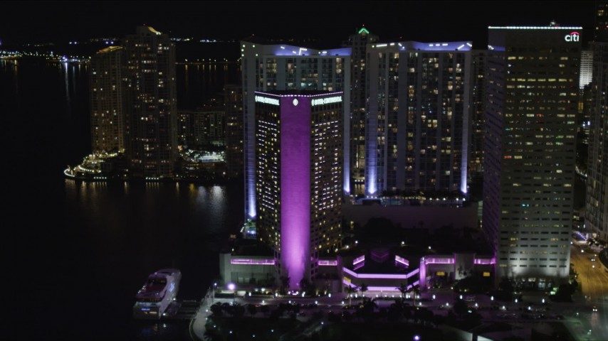 5K stock footage aerial video approach InterContinental Miami Hotel in Downtown Miami at night, Florida Aerial Stock Footage | AX0023_046