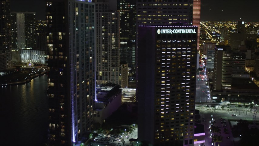 5K stock footage aerial video of InterContinental Miami Hotel at nighttime in Downtown Miami, Florida Aerial Stock Footage | AX0023_048