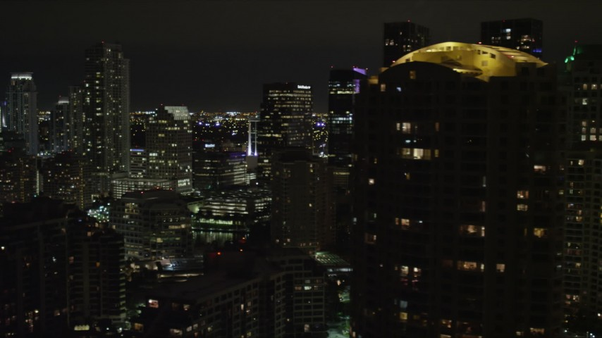 5K aerial video flyby skyscrapers on Brickell Key in Downtown Miami at night, Florida Aerial Stock Footage | AX0023_049